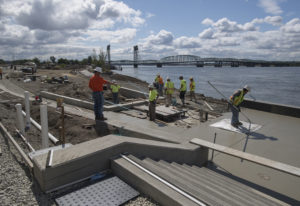 Construction crews works at The Waterfront Vancouver, near where the park and water feature meet the