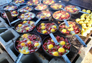 Crispy paella topped with a duck egg prepared by Chef Mike Campos of Lapellah
