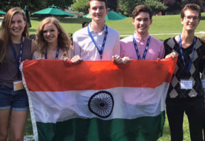 Lake Shore: Andrew Douglas, center, and other students who received a language scholarship from the