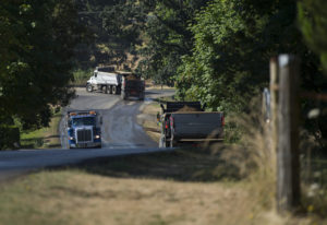 A trio of trucks travel to and from the Zimmerly gravel pit near Washougal. (Amanda Cowan/The Columb
