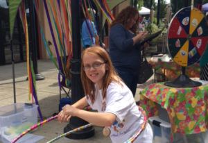 Battle Ground: Brynlee Hammond testing her hula hoop skills at Summertime YUM! booth at the Battle G