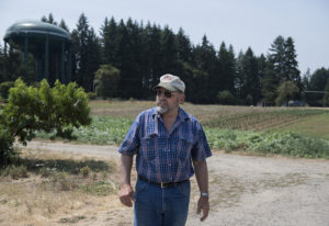Joe's Place Farms owner Joseph Beaudoin stands near land that he is selling to Ginn Development, whi