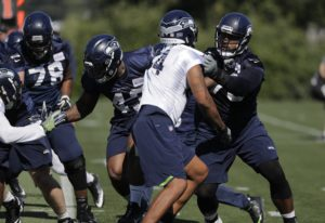 Seattle Seahawks' offensive tackle Duane Brown, right, takes part in a drill with linebacker Ma