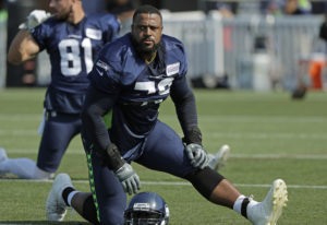 Seattle Seahawks offensive tackle Duane Brown stretches during NFL football training camp, Sunday, J