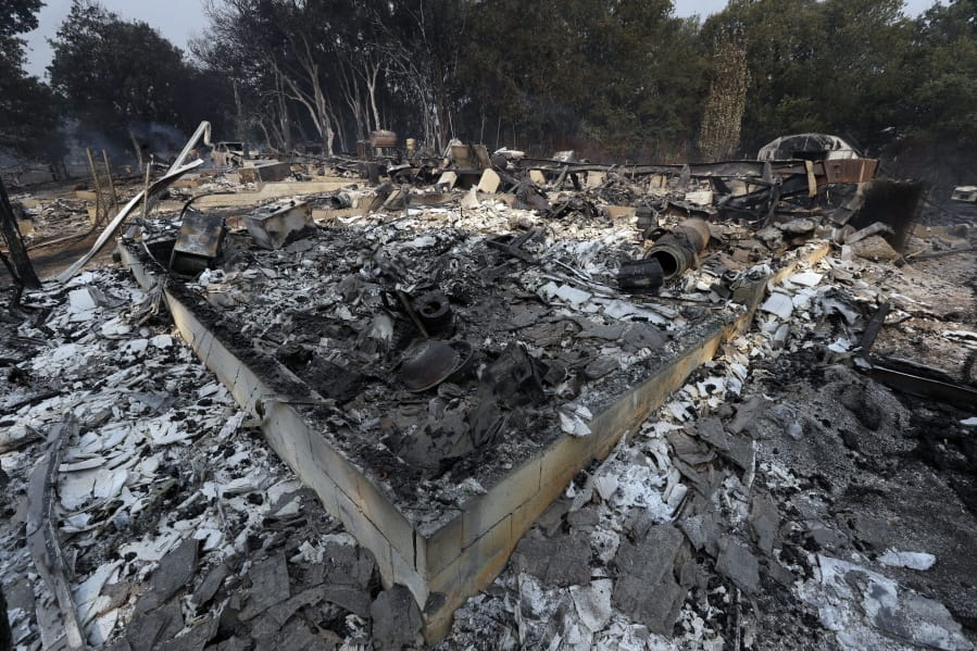 Strong winds whipping up new threat as California wildfires continue to rage