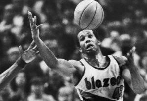 FILE - In this Dec. 25, 1979, file photo, Portland Trail Blazers' Kermit Washington gains control of