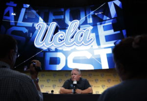 UCLA coach Chip Kelly talks to reporters at the Pac-12 Conference NCAA college football media day in