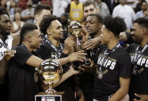 The Portland Trail Blazers celebrate after defeating the Los Angeles Lakers in an NBA summer league