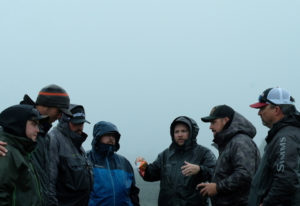 Marlin Lefever (center) discusses strategy with members of the Addicted team in Alaska. Addicted wil