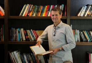 Neal Thompson, an author and the chief of Amazon's Literary Partnership, which gives cash to literar
