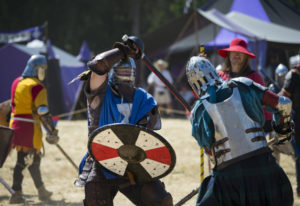 Jeff Parker of La Pine, Ore., also known as Tryggr, center in blue, takes on a fellow combatant duri
