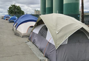 No tents were here on Wednesday, but these were back on Friday. (Lou Brancaccio for The Columbian)