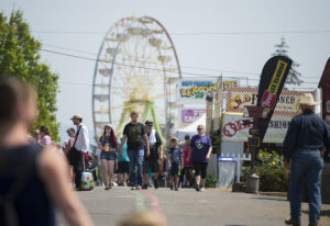 Crowds pass rides, food and exhibits as they stroll among the attractions at the Clark County Fair o