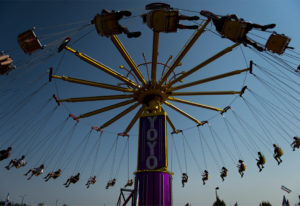 Attendees at the Clark County Fair ride the Yoyo swing ride on Tuesday afternoon, Aug. 7, 2018. (Nat
