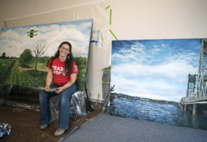 Trader Joe's artist Crystal Humble Lary of Vancouver works on a mural of the Fort Vancouver apple or