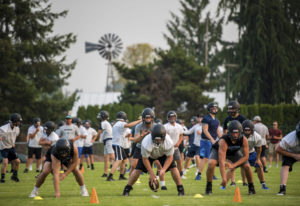 Hockinson players prepare to run a passing drill during the first practice of the year at Hockinson