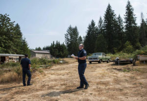 Fire Marshal Chris Drone, left, and Risk Specialist Jacob Guisinger lead a wildfire survey at a rura