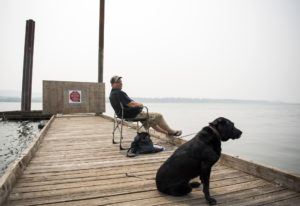 Randy Rolene of Vancouver relaxes with his dog Bella and fishes off of the dock at Steamboat Landing