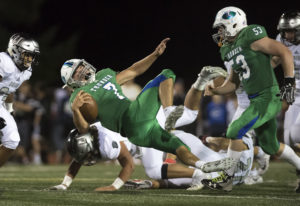 Mountain View's Jack Mertens (7) is taken down by Union defenders in the third quarter at McKen