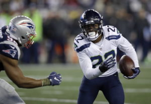 New England Patriots defensive lineman Trey Flowers (98) chases Seattle Seahawks running back C.J. P