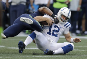 Indianapolis Colts quarterback Andrew Luck (12) is tackled by Seattle Seahawks linebacker Bobby Wagn