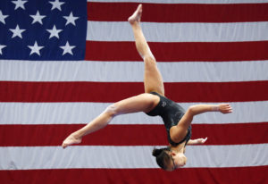 Morgan Hurd practices on the balance beam during a training session at the U.S. Gymnastics Champions