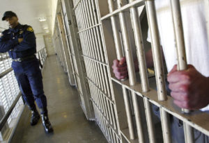 FILE - In this Feb. 2, 2005 file photo Washington state prisons Lt. Clan Jacobs walks through a bloc