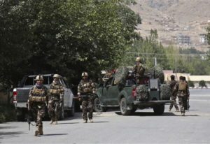 Afghan security forces arrive at the site of an attack Thursday in Kabul, Afghanistan. Gunmen besieg