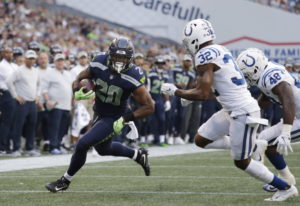 Seattle Seahawks running back Rashaad Penny (20) rushes past Indianapolis Colts defensive back T.J.