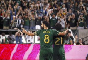 Portland Timbers' Diego Valeri (8) and Diego Chara (21) celebrate after Chara's second-hal