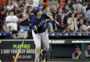 Seattle Mariners' Ryon Healy drops his bat after hitting a home run against the Houston Astros durin