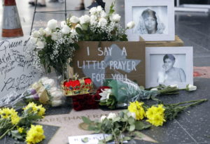 Flowers and signs are placed on Aretha Franklin's star at the Hollywood Walk of Fame Thursday in Los