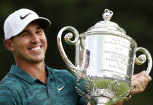 Brooks Koepka holds the Wanamaker Trophy after he won the PGA Championship golf tournament at Beller