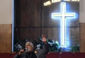 New Bethel Missionary Baptist Church Pastor Robert Smith Jr. sings at the beginning of a prayer vigi