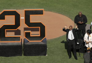 Former San Francisco Giants player Barry Bonds waves to fans next to his mother, Pat, as he is honor