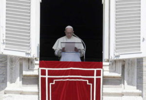 In this Sunday, Aug. 19, 2018 file photo, Pope Francis prays for the victims of the Kerala floods du