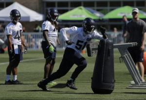Seattle Seahawks linebacker Barkevious Mingo (51) running a drill during NFL football training camp,
