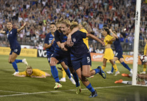 Lindsey Horan (9), hugged by teammate McCall Zerboni after scoring a goal against Australia, is curr