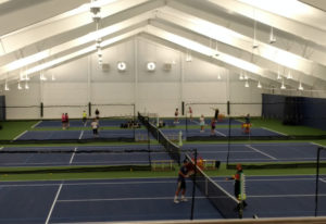 Tennis players enjoy the first hits on the renovated Vancouver Tennis Center courts after the facili