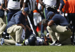 Seattle Seahawks wide receiver Doug Baldwin stays on the field injured during the first half of an N