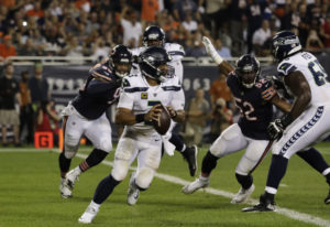 Seattle Seahawks quarterback Russell Wilson (3) looks to throw against the Chicago Bears during the