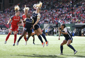 Portland Thorns' Crystal Dunn (19) heads the ball away during a National Women's Soccer Le