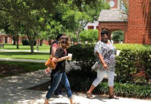 Milly Horsley, left in black shirt, and Gracie Robinson, right, walk to class at New Orleans Baptist