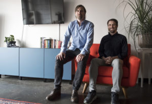 Creative Director Kyle Sullivan, left, and his brother, Design Director Derek Sullivan, pose togethe