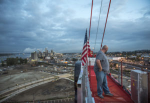 Randy Anis stands atop the tower crane he operates at The Waterfront Vancouver just after 6 a.m. Sep