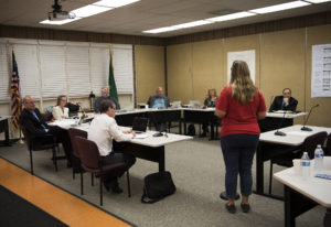 The Battle Ground Public Schools board listens to public comment during a meeting on Sept. 10 at the