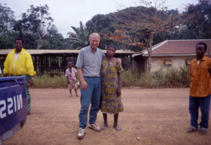 WSU Vancouver anthropology professor Barry Hewlett, left, poses with an Ebola survivor in the Republ