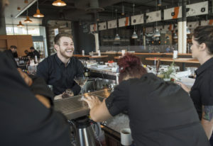 Nick Yahn of Battle Ground, a WildFin American Grill bartender, laughs while practicing menu cocktai