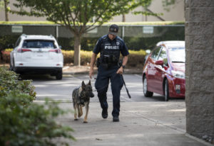 Officer Rocky Epperson and his canine Koa are pictured outside the Vancouver Police Department West