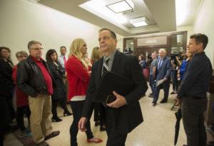 Mark Ross, superintendent of the Battle Ground Public Schools, center, walks past striking teachers